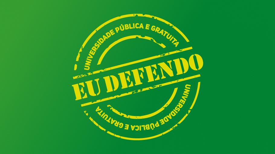 """Fundo verde escuro. Selo amarelo escrito """"eu defendo""""."""
